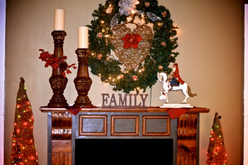 The faux fireplace in the day room adorned for the holidays